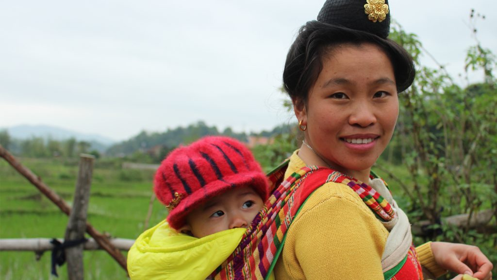 Vietnamese woman w/ baby on her back Photo credit: @2017 CARE