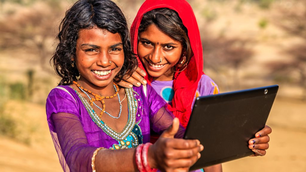 Two Indian girls with laptop